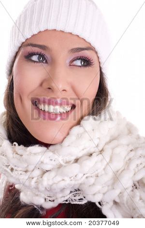 beautiful woman wearing winter scarf and hat