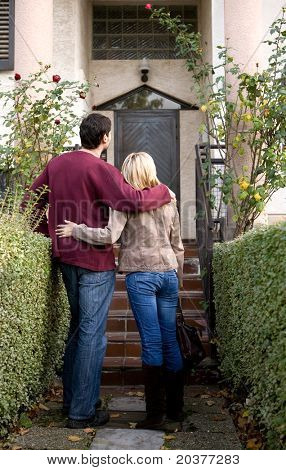 couple in front of the house