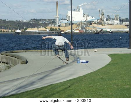 Skateboarder By Water