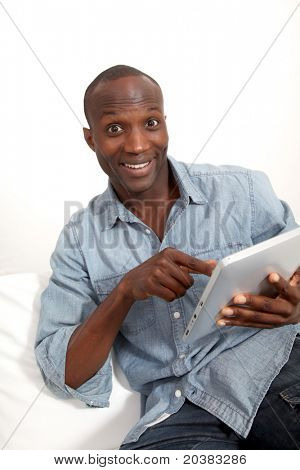 Funny man using electronic tablet at home