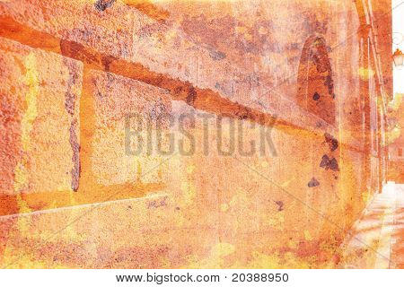warm orange background of a grunge wall in France