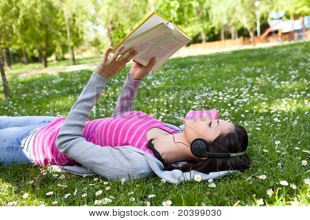 Girl Relaxing And Enjoying On Grass