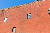 The wall of the house of red brick, firewall, Saint Petersburg, Russia. poster