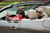 image of luxury cars  - Happy young couple in a convertible car - JPG