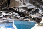 Vehicle Lift Up By Hydraulic For Engine Oil Change And Transmission Inspection. Changing Motor Oil I poster