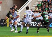 NORTHAMPTON, UK - SEPT 05: Saints tackle Alesana Tuilagi with the ball during Northampton Saints vs
