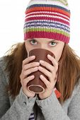 pic of hot-chocolate  - Young woman in winter hat with cup of hot chocolate or coffee or tea - JPG