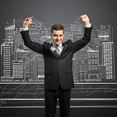stock photo of woohoo  - happy businessman with hands up - JPG