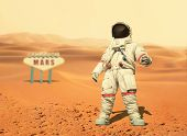 Spaceman Walks On The Red Planet Mars. Space Mission. Welcome To Mars Sign. Astronaut Travel In Spac poster