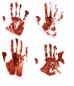 stock photo of gory  - Four bloody hand imprints on paper surface - JPG