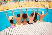 Put Your Hands Up! Pool Disco Party. Six Excited Cheerful Multi Ethnic Friends Are Chilling By The P poster
