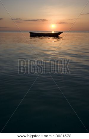 Portrait Shot Of Row Boat At Sunset In Africa Zanzibar