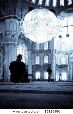 Praying Muslim man  silhouette in Kocatepe Mosque - Ankara, Turkey - Split toned