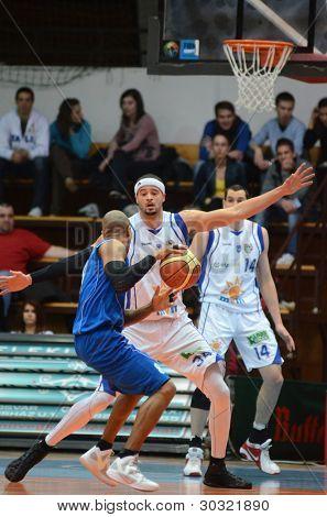 KAPOSVAR, HUNGARY â?? FEBRUARY 18: Michael Fey (white, 34) in action at a Hungarian Championship basketball game with Kaposvar (white) vs. Fehervar (blue) on February 18, 2012 in Kaposvar, Hungary.