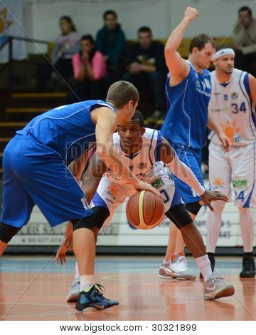 KAPOSVAR, HUNGARY – FEBRUARY 18: Kwadzo Ahelgebe (white, 20) in action at a Hungarian Championship basketball game with Kaposvar (white) vs. Fehervar (blue) on February 18, 2012 in Kaposvar, Hungary.