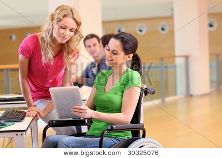 Handicapped person at work with electronic tablet