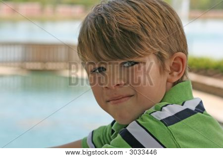 Image of a young boy with a bridge