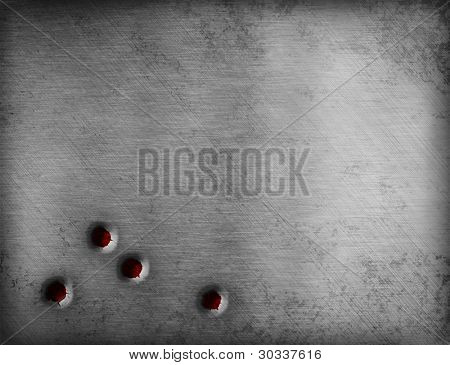 bullet holes on metal plate