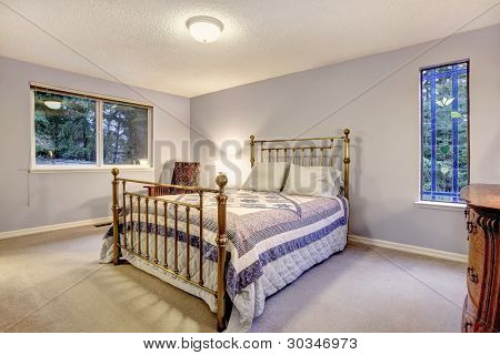Blue Simple Bedroom With Metal Frame Bed.