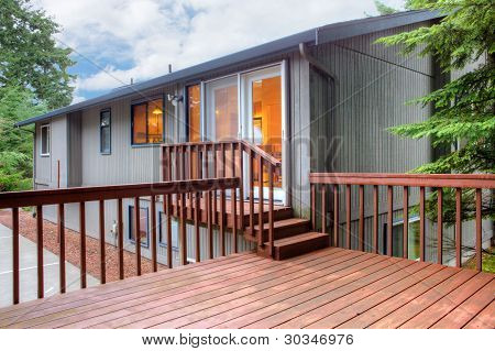 Back Of The House With Wooden Deck.