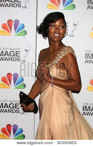 LOS ANGELES - FEB 17:  Megan Good arrives at the 43rd NAACP Image Awards at the Shrine Auditorium on February 17, 2012 in Los Angeles, CA.