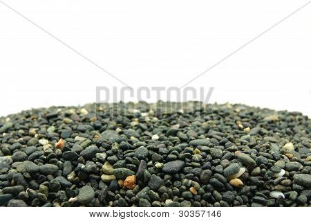 pile of rocks below with a white background
