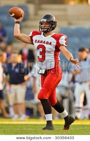 GRAZ, AUSTRIA - JULY 9: QB Michael Faulds (#3 Canada) passes the ball at the Football World Championship on July 9, 2011 in Graz, Austria. Canada wins 45:10 against France.