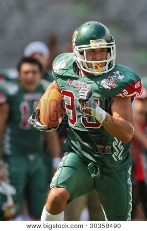 INNSBRUCK, AUSTRIA - JULY 10: WR Oscar Ru?z (#85 Mexico) runs with the ball at the Football World Championship on July 10, 2011 in Innsbruck, Austria. Mexico wins 65:0 against Australia.