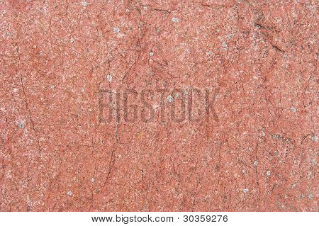 Natural Red Stone Surface Covered By Moss