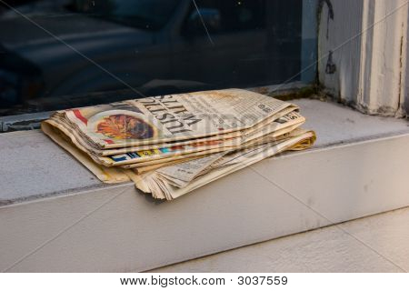 Old Newspaper On Window Sill