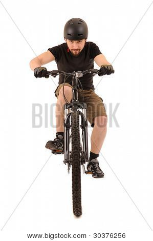 Riding bicyclist isolated on white, studio shot.