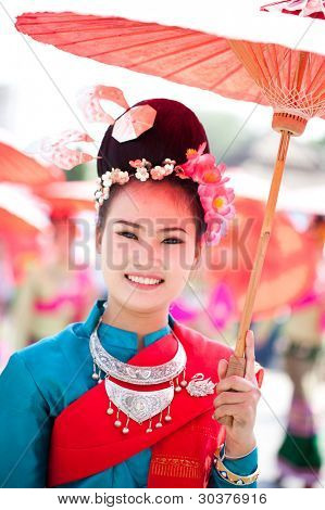 CHIANG MAI, THAILAND - FEBRUARY 4: Traditionally dressed woman portrait in procession on Chiang Mai 36th Flower Festival on February 4, 2012 in Chiang Mai, Thailand