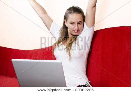 Happy Woman In Front Of Her Laptop