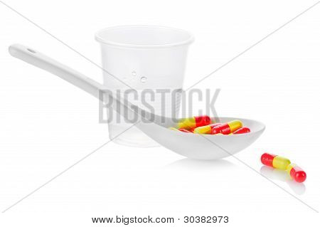 Pharmacy. Antibiotic Pills And Plastic Glass Of Water
