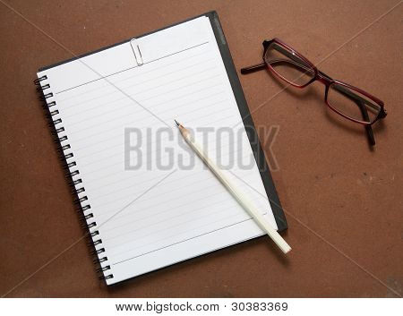 New Black Notebook With White Pencil And Glasses