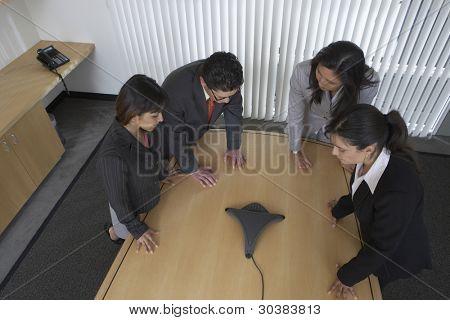 Business professionals using speaker phone