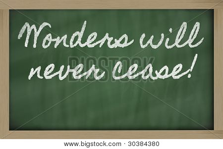 Expression -  Wonders Will Never Cease - Written On A School Blackboard With Chalk