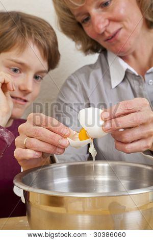 mother and son opening an egg