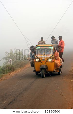 Agricultural labourers travelling in a crowded Auto