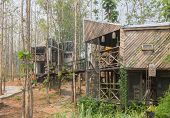 2 Exterior House Design By Wood And Concrete In Country Style Side View. Exterior House Among Natura poster
