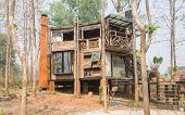 Exterior House Design By Wood And Concrete In Country Style. Exterior House Among Natural Forest. Co poster