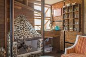 Fireplace And Arm Chair And Glass Shelf In Country Loft Interior Design Room. Interior Design Room I poster