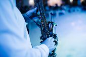 Musician Playing Saxophone Indoors.musician Playing Saxophone Close Up poster