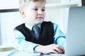 Small Cute Boy In Business Suit With A Tie Works At Computer At Office. Small Business Man, Little B poster