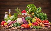 Assortment of fresh organic vegetables and fruits in wicker basket. Selection of organic food for he poster