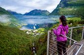 Geiranger fjord, Beautiful Nature Norway panorama. The fjord is one of Norways most visited tourist poster