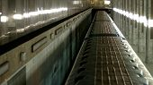Metro Train Moving In Tunnel, Top View. Underground Train Arriving At Subway Station, View From Abov poster