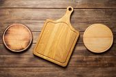 cutting board at wooden plank table board background, top view poster