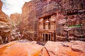 Magnificant and famous facade in Petra Jordan, the treasury or Al Khazna poster
