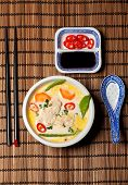 foto of gai  - thai tom kha gai soup with a spoon - JPG